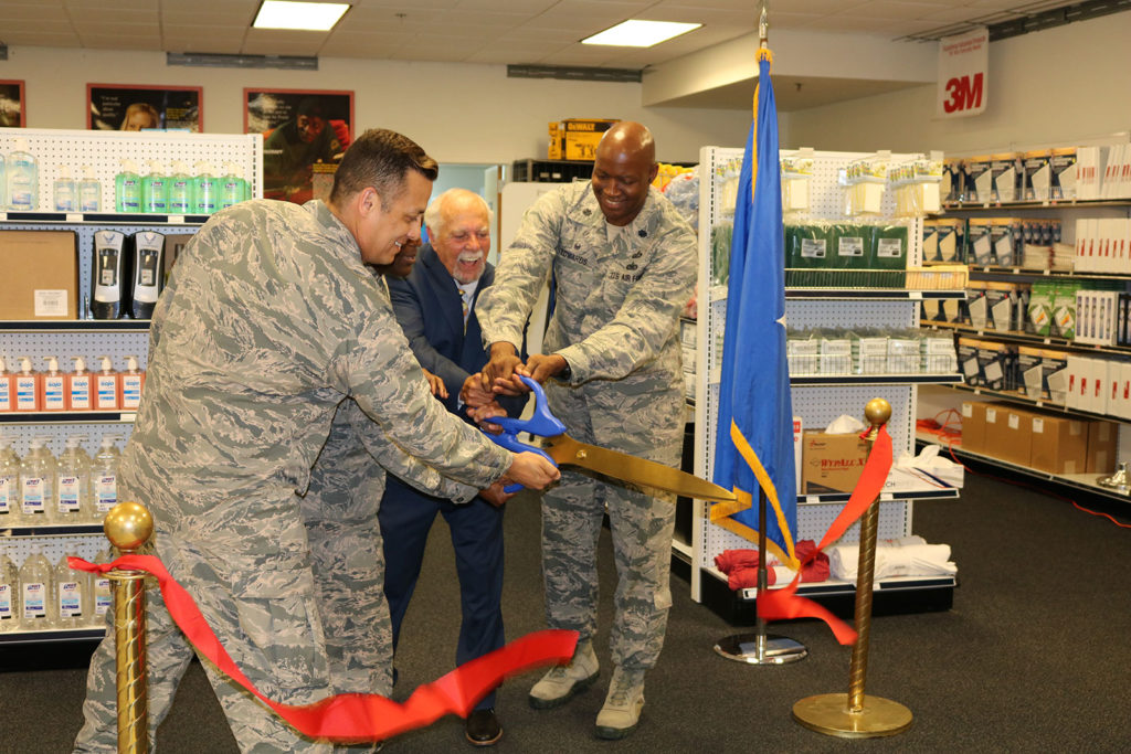 The final snip in the cutting of the ribbon with military personnel and Buddy